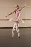 Beautiful ballerina dancing en pointe Royalty Free Stock Image