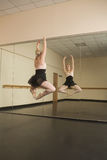 Beautiful ballerina dancing in front of mirror Royalty Free Stock Photography