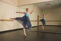 Beautiful ballerina dancing in front of mirror Stock Image