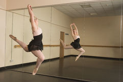 Beautiful ballerina dancing in front of mirror Stock Images