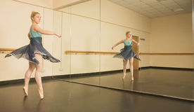 Beautiful ballerina dancing in front of mirror Stock Photography