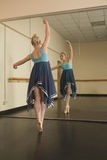 Beautiful ballerina dancing in front of mirror Royalty Free Stock Photo