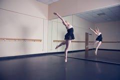 Beautiful ballerina dancing in front of mirror Stock Photos