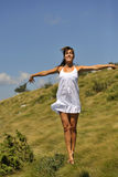 Beautiful ballerina dancing in nature royalty free stock photography
