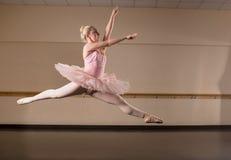 Beautiful ballerina dancing in pink tutu Royalty Free Stock Images