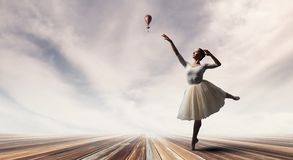 Elegant ballerina dancing. Mixed media stock images