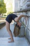 Beautiful ballerina doing exercises for dancing outdoors Stock Photo
