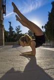Beautiful ballerina doing exercises for dancing outdoors Royalty Free Stock Photos