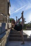 Beautiful ballerina doing exercises for dancing outdoors Stock Photography