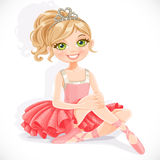 Beautiful  ballerina girl in pink dress sit on floor Royalty Free Stock Images