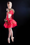 Beautiful ballerina girl in a red tutu with python Stock Photo