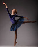 Beautiful ballerina with perfect body in blue tutu outfit dancing in studio. ballet art. Stock Photography