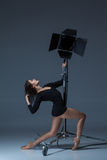 The beautiful ballerina posing on dack blue Royalty Free Stock Photo