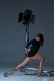 The beautiful ballerina posing on dack blue Royalty Free Stock Photos