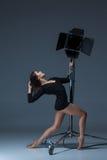 The beautiful ballerina posing on dack blue Royalty Free Stock Image