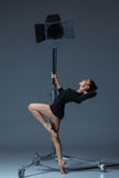 The beautiful ballerina posing on dack blue Stock Photography