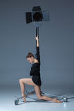 The beautiful ballerina posing on dack blue Stock Image