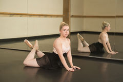 Beautiful ballerina posing in front of mirror Stock Photos