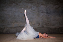 The beautiful ballerina posing in long white skirt Royalty Free Stock Images