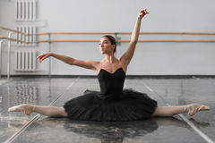 Beautiful ballerina sit on the twine in class Stock Photography