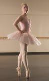 Beautiful ballerina standing en pointe Stock Image