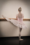 Beautiful ballerina warming up with the barre Royalty Free Stock Photo