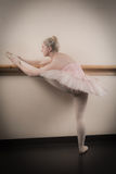 Beautiful ballerina warming up with the barre Royalty Free Stock Photos