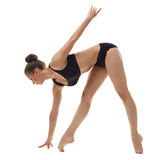 Beautiful ballerina warming up, isolated on white Stock Photo