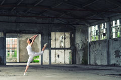 Beautiful ballerina in white dancing and jumping high in the air Stock Photos