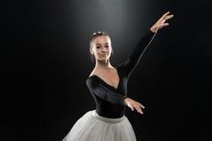Beautiful Ballerina In White Tutu Doing Acrobatics Stock Image