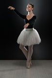 Beautiful Ballerina In White Tutu Doing Acrobatics Royalty Free Stock Images