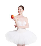 Beautiful ballerine with apple isolated on white background Royalty Free Stock Photography