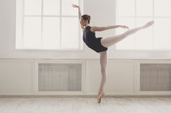 Beautiful ballerine stands in arabesque ballet position Stock Images