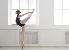 Beautiful ballerine stands in arabesque ballet position Stock Photography