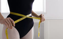 Beautiful ballerine torso with measuring tape, slim waist after diet Stock Photography