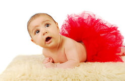 A beautiful  ballet  baby laying on a fur rug Royalty Free Stock Photography