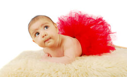 A beautiful  ballet  baby laying on a fur rug Stock Photography