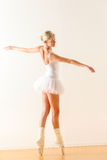 Beautiful ballet dancer dancing in the studio Stock Photos