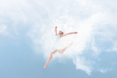 Beautiful ballet dancer jumping inside cloud of powder Royalty Free Stock Photo