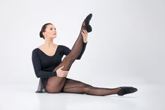 Beautiful ballet dancer lifting foot Royalty Free Stock Photo