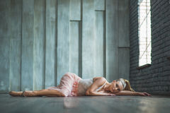 Beautiful ballet dancer lying on floor Royalty Free Stock Images