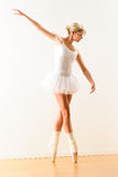 Beautiful ballet dancer practicing dance posture Stock Photos