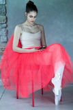 Beautiful ballet dancer sitting in relax Royalty Free Stock Image