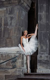 Beautiful ballet woman on stairs. Grace in any situation. Beautiful female ballet dancer practicing outdoors soft focus Royalty Free Stock Image