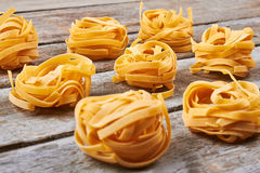Beautiful balls handmade tagliatelle pasta. Royalty Free Stock Photos