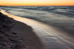 Beautiful Baltic sea beach at sunset Stock Image