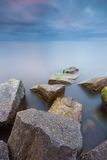 Beautiful Baltic sea landscape with stone breakwater. Royalty Free Stock Photos
