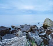 Beautiful Baltic sea landscape with stone breakwater. Royalty Free Stock Photo