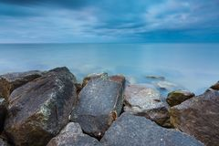 Beautiful Baltic sea landscape with stone breakwater. Stock Photography