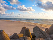 Beautiful Baltic sea landscape with stone breakwater. Royalty Free Stock Images